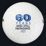 """Funny Golf Balls 60th Birthday Party Monogrammed<br><div class=""""desc"""">Your golfer who is turning sixty will get a laugh from these personalized Golf Balls. Features a design with text that reads &quot;60 Years And Still Swinging&quot;. (You can change the number to any year.) Personalize with monogrammed initials, name or date. A perfect for gift or party favor for a...</div>"""