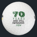 """Funny Golf Balls 70th Birthday Party Monogrammed<br><div class=""""desc"""">Your golfer who is turning seventy will get a laugh from these personalized Golf Balls. Features a design with text that reads &quot;70 Years and Still Swinging&quot;. (You can change the number to any year and color to your choice.) Personalize with monogrammed initials, name or date. A perfect for gift...</div>"""