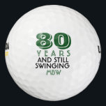 """Funny Golf Balls 80th Birthday Party Monogrammed<br><div class=""""desc"""">Your golfer who is turning eighty will get a laugh from these personalized Golf Balls. Features a design with text that reads &quot;80 Years and Still Swinging&quot;. (You can change the number to any year and color to your choice.) Personalize with monogrammed initials, name or date. A perfect for gift...</div>"""
