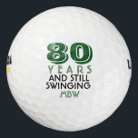 """Funny Golf Balls 80th Birthday Party Monogrammed<br><div class=""""desc"""">Your golfer who is turning eighty will get a laugh from these personalized Golf Balls. Features a design with text that reads """"80 Years and Still Swinging"""". (You can change the number to any year and color to your choice.) Personalize with monogrammed initials, name or date. A perfect for gift...</div>"""