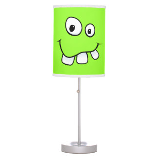 Funny, goofy, green cartoon face desk lamp