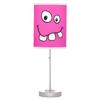 Funny, goofy, pink cartoon face desk lamp