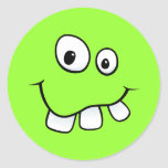 Funny goofy smiley face with big teeth, green stickers