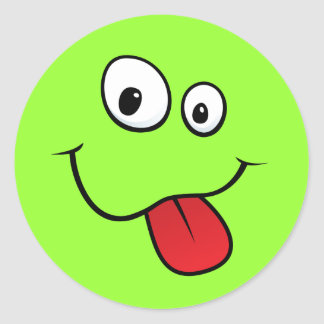 Funny goofy smiley sticking out his tongue, green classic round sticker