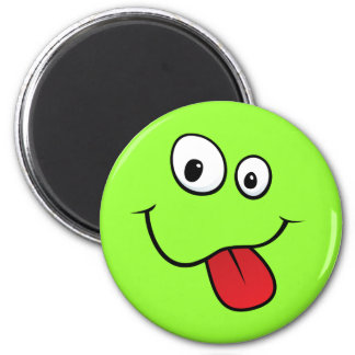 Funny goofy smiley sticking out his tongue, green 2 inch round magnet