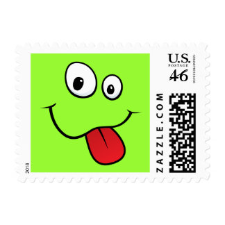Funny goofy smiley sticking out his tongue green stamp