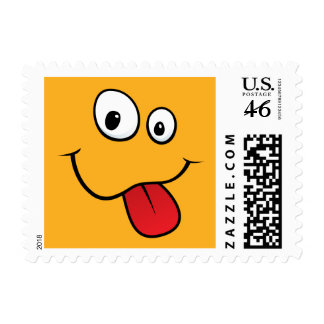 Funny goofy smiley sticking out his tongue orange stamp