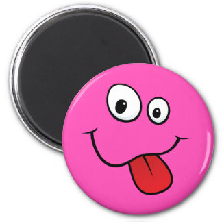 Funny goofy smiley sticking out his tongue, pink 2 inch round magnet