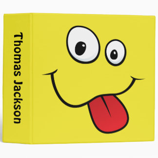 Funny goofy smiley sticking out his tongue, yellow 3 ring binder
