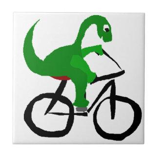 Funny Green Dinosaur Riding Bicycle Ceramic Tile