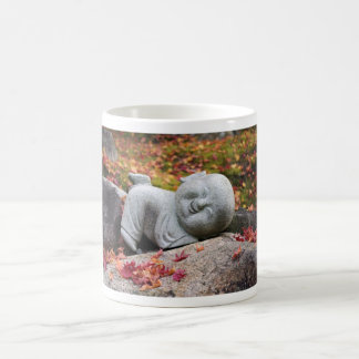 Funny Japanese monk statue with autumn leaves Mugs