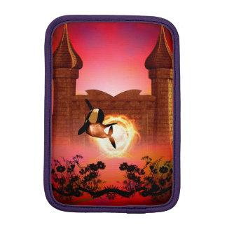 Funny, jumping orca in the sunset iPad mini sleeve