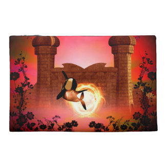 Funny, jumping orca in the sunset travel accessories bags