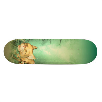 Funny kitten with baby cat in the wood skateboard deck