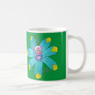 Funny looking creature on a flower, on a mug. coffee mug