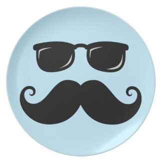 Funny mustache and sunglasses face on blue plate