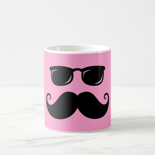 Funny mustache and sunglasses face on pink mug