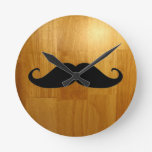 Funny Mustache on Shiny Wood Texture Background Round Clocks