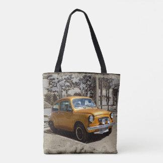 Funny old gold car tote bag