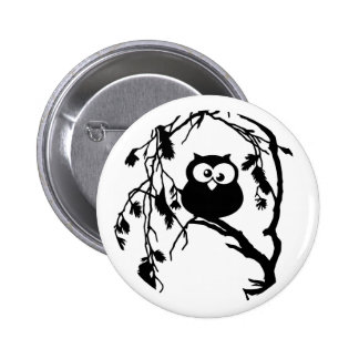 Funny owl sitting in the tree and has the moon pin