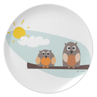 Funny owls on branch on sunny day dinner plate