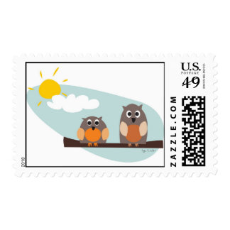 Funny owls on branch on sunny day postage stamp
