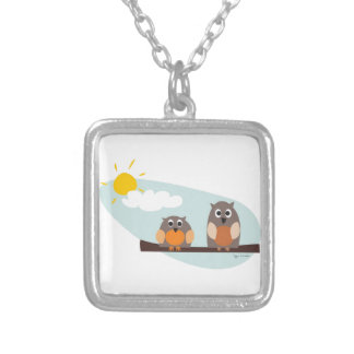 Funny owls on branch on sunny day silver plated necklace