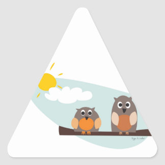 Funny owls on branch on sunny day triangle sticker