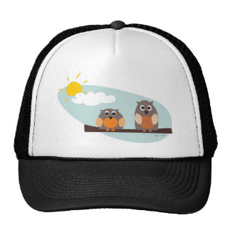 Funny owls on branch on sunny day trucker hat