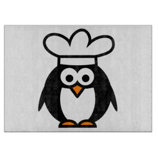Funny penguin chef cartoon glass cutting board