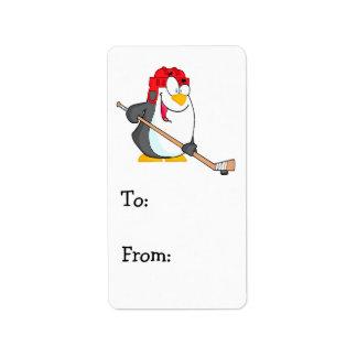 funny penguin playing ice hockey cartoon label