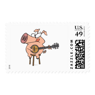 funny pig playing a banjo cartoon character postage stamp