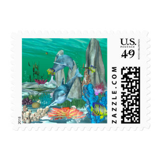 Funny playing dolphins with other fish postage stamp