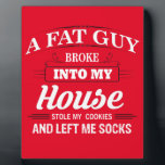 """Funny Santa Claus Christmas Saying Plaque<br><div class=""""desc"""">Funny Santa Claus Christmas Saying on multiple items in the store.  &quot;A fat guy broke into my house,  stole my cookies,  and left me socks&quot;.  Get these items as a christmas gift for someone,  or treat yourself this xmas.</div>"""