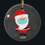 "Funny Santa Claus Wearing Facemask 2020 Christmas Ceramic Ornament<br><div class=""desc"">A funny Christmas ornament featuring a Santa wearing a facemask set against a black ""chalkboard"" background.  So appropriate for these times.</div>"