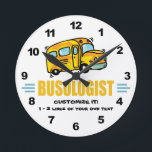 "Funny School Bus Round Clock<br><div class=""desc"">BUSOLOGIST. Humorous title for someone who drives a school bus,  works on a school bus,  rides a school bus and other folks,  too. Design features a big yellow school bus. Makes a great gift! Find other funny designs like this one at the Ologist Shop.</div>"