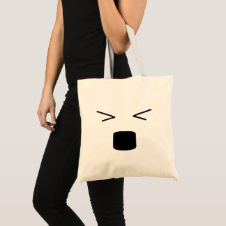 Funny smiley hurting face tote bag