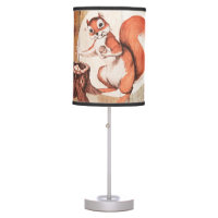 Funny squirrel on wood desk lamp