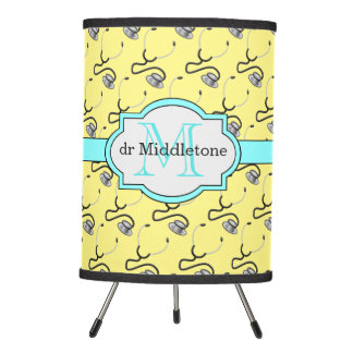 Funny stethoscopes for doctors on yellow name tripod lamp
