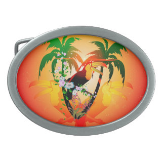 Funny toucan sitting on a branch oval belt buckles