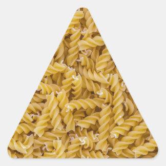 Fusilli pasta macro as background structure triangle sticker