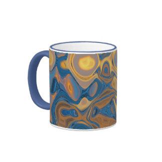 Fusión del azul y del oro - taza de los azules