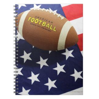 Fútbol americano con la bandera de los E.E.U.U. Libretas