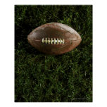 Fútbol americano en hierba, visión desde arriba póster