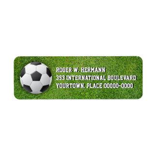 Fútbol del fútbol en la hierba etiqueta de remite