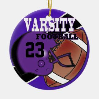 Fútbol púrpura y negro del equipo universitario adorno navideño redondo de cerámica