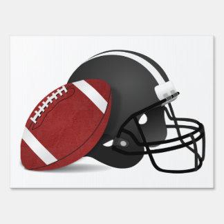 Fútbol y casco carteles