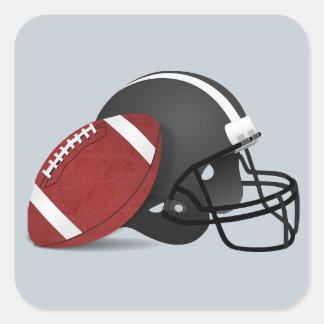 Fútbol y casco en el pegatina gris