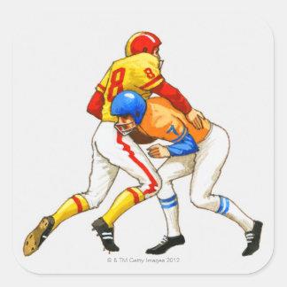Futbolista americano que bloquea a un opositor calcomanias cuadradas