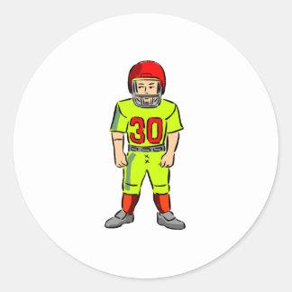 Futbolista de los niños etiqueta redonda